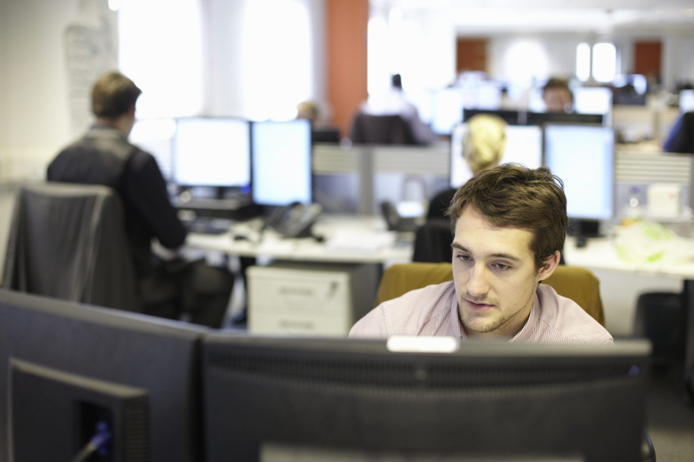 Man on phone in call centre