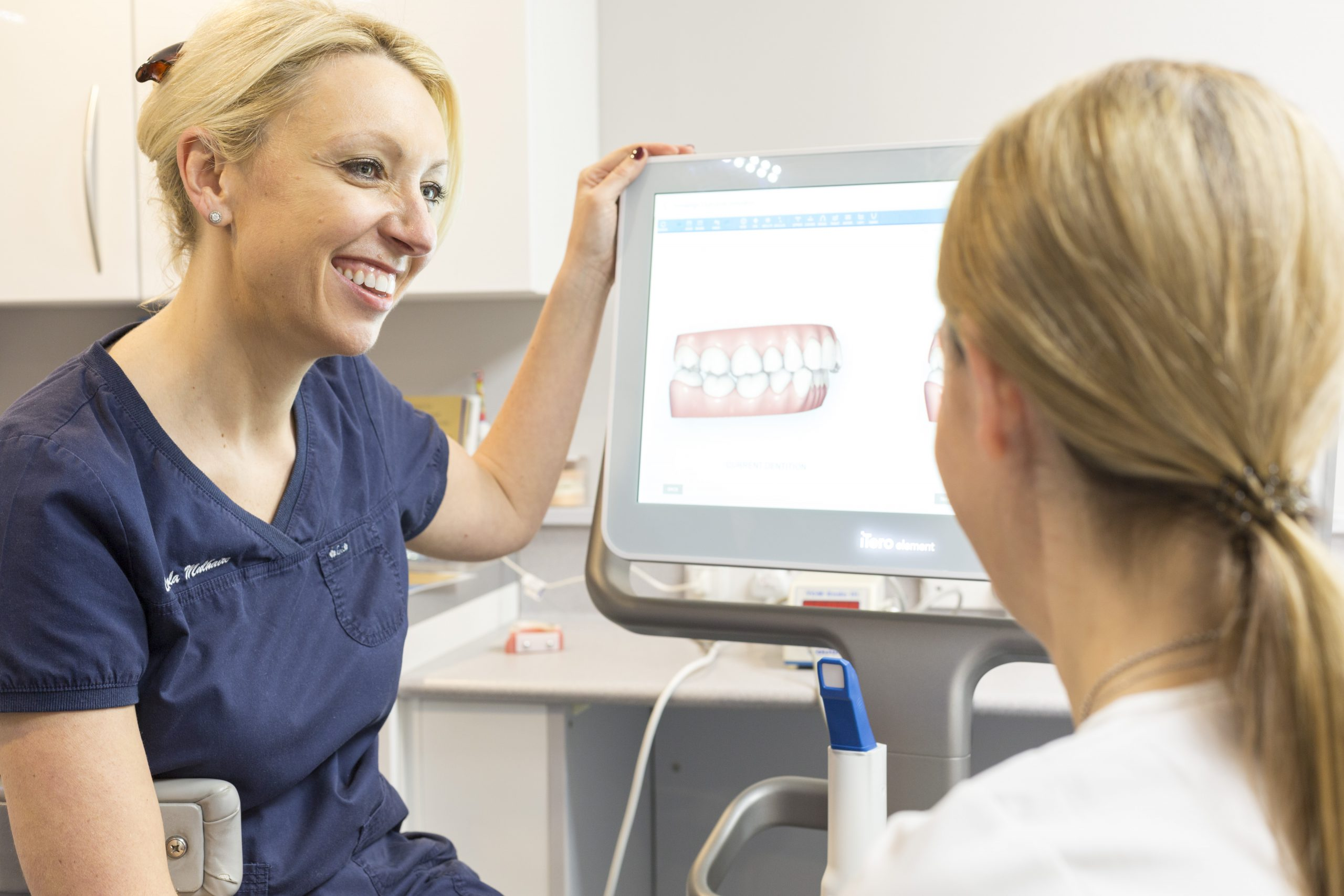 Employed Dentist talking to a patient